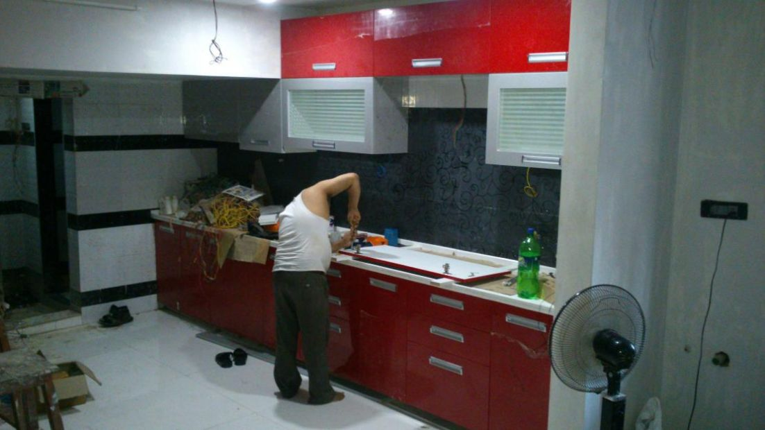 Modular kitchen under construction in delhi india for Best material for kitchen cabinets in india